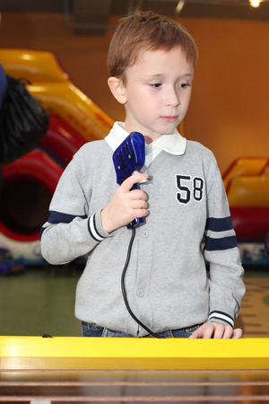 handsome little boy playing on the race Banco de Imagens - 98482647