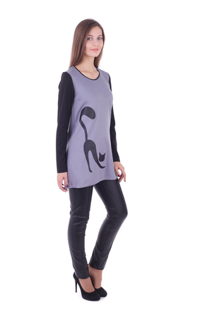 pretty young girl wearing grey tunic cat decorated