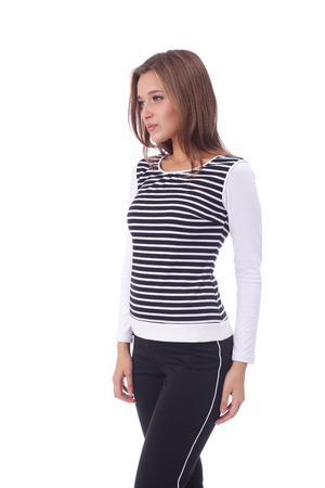 pretty young girl wearing striped top and black pants