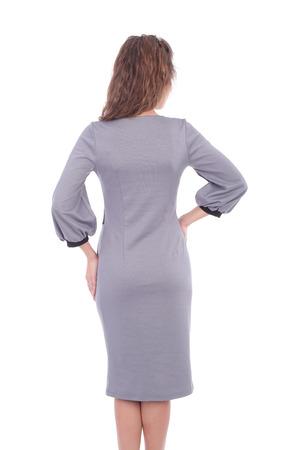Young girl wearing grey dress