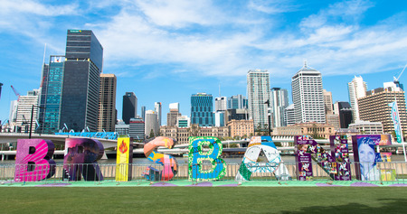 Brisbane, Australia - December 5, 2016: View of Brisbane City skyscrapers with colorful block characters of city name, taken from the South bankView of Brisbane City skyscapers with colorful block characters of city name, taken from the Southbank