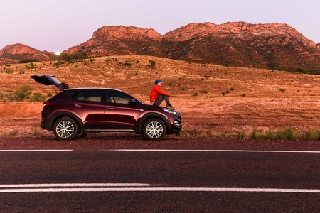 suv: Landscape view with a SUV car Editorial