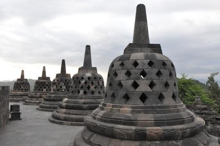 Ancient Buddha statue at Borobudur temple in Yogyakarta, Java, Indonesia. Stock Photo