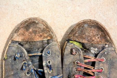 uniform green shoe: Old shoe was left in a construction zone