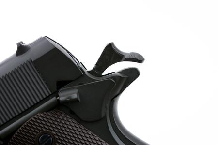 Trigger of gun on white background