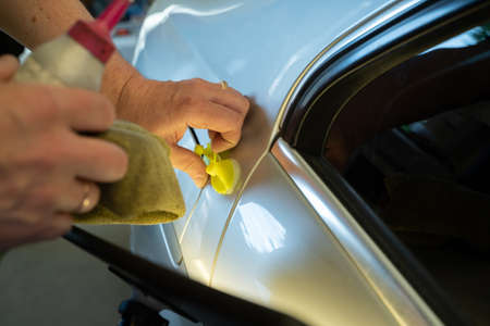 Process Of Paintless Dent Repair On Car Body. Technician s Hands With Puller Fixing Dent On Rear Car Fender. PDR Removal Course Training