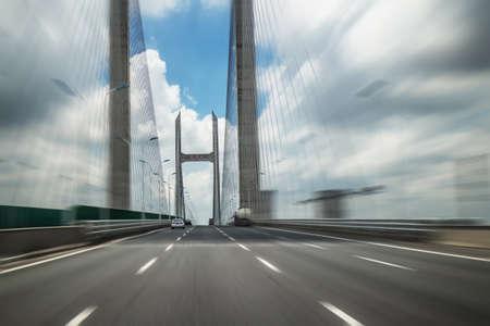 Traveling on the Minpu Bridge in Shanghai, China 版權商用圖片