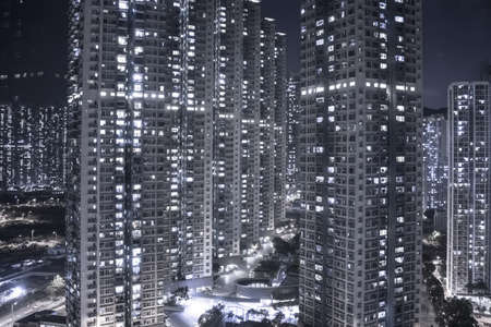 View of apartments in city at night