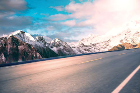 Scenic view of mountains by a highway