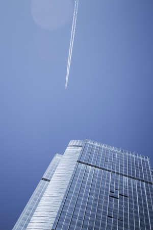 View of the contrails of jet aircraft in the city