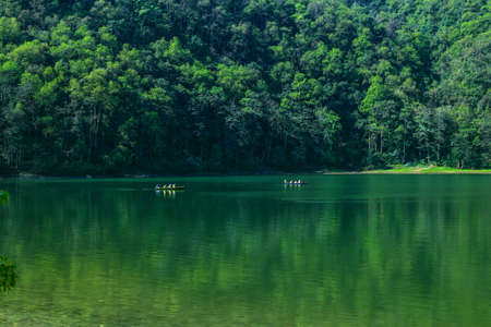 People canoeing on a lake