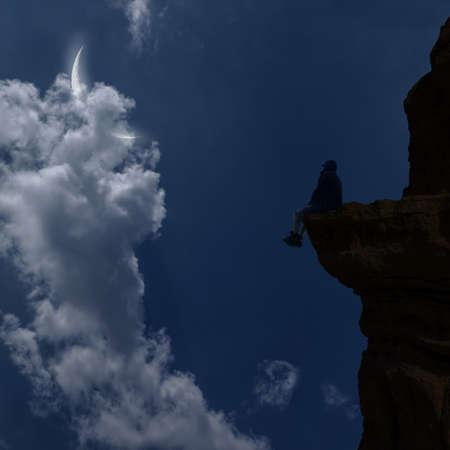Young man sitting on the cliff 版權商用圖片
