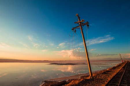 Electric poles near the railway track 版權商用圖片