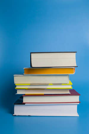 A stack of book on blue background 版權商用圖片