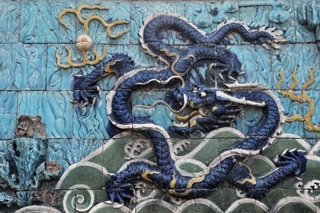Dragon symbol of the Chinese Empire and its emperor on the Nine dragon wall in Beijing