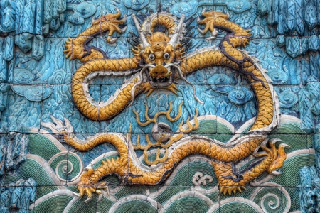 Dragon symbol of the Chinese Empire and its emperor on the Nine dragon wall in Beijing 写真素材 - 103138974