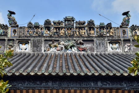 The pottery crest on the roof of the Chinese ancestral hall.