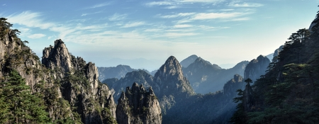 Huangshan, Yellow Mountain, in Anhui Province in China. Well-known for its scenery, peculiarly shaped granite peaks, Huangshan pine trees and views of the clouds from above.