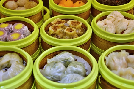 Dim sum is a style of Chinese cuisine (especially Cantonese) prepared as small bite-sized portions of food served in small steamer baskets or on small plates. Reklamní fotografie
