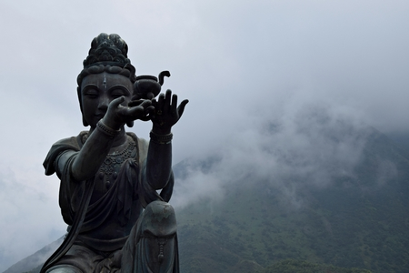 Detail of the bronze Buddhist statues praising and making offerings to the Tian Tan Buddha, also known as the Big Buddha, located in Lantau Island in Hong Kong. Reklamní fotografie