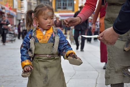 LHASA, TIBET AUTONOMOUS REGION, CHINA - CIRCA MAY 2018: Mother and her daughter on their pilgrimage to Lhasa. Editorial