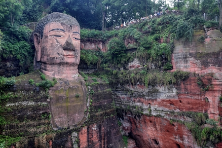 The detail of Leshan Giant Buddha 71 meters tall stone statue carved out of the cliff, faces confluence of Min River and Dadu River.