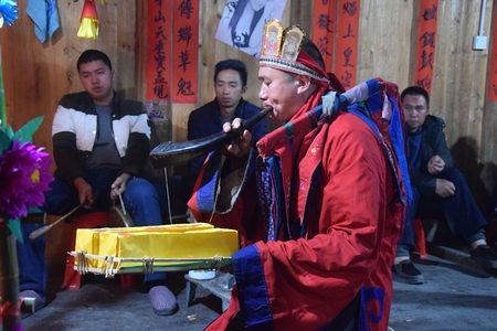 GUIZHOU PROVINCE, CHINA CIRCA DECEMBER 2018: The ritual redeeming the vow in a village of Guizhou accompanied by theatrical performance did by the ritual masters. Translation of text: worship nature and ancestors.