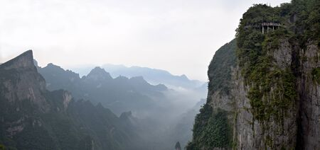 Tianmen Mountain, Heavens Gate Mountain, is located within Tianmen Mountain National Park, Zhangjiajie, in the northwestern part of Hunan Province, China.