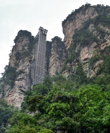 "Zhangjiajie the ""Avatar"" mountains in Hunan province in China. Thousand and thousand rock soar to skyward. The evergreen pine trees struggle on the top of the hills. Banco de Imagens"