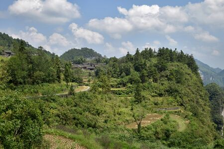 Mountainous landscape around well known Aizhai bridge in Hunan province in China. Banco de Imagens