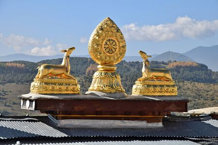 Folden statues on the roofs of Guishan Temple in Shangri La town in Yunnan Province in China.