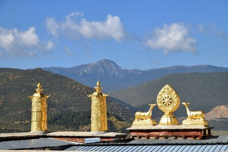 Golden statues on the roofs of Guishan Temple in Shangri La town in Yunnan Province in China.