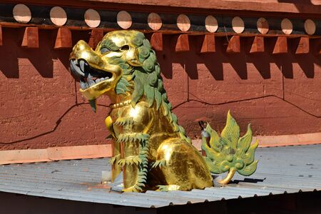 Golden statue in Guishan Temple in Shangri La town in Yunnan Province in China.