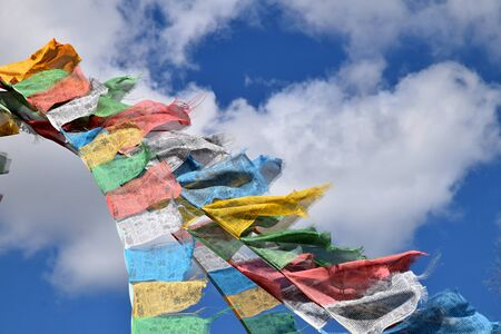 Tibetan prayer flags, colorful rectangular clothes, use to bless the surrounding countryside, blowing in the wind. Banco de Imagens