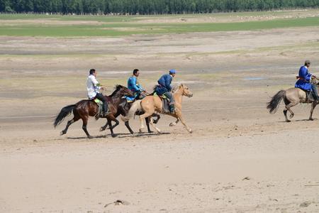 mongolia horse: Herdsmen in Inner Mongolia having horse racing competition