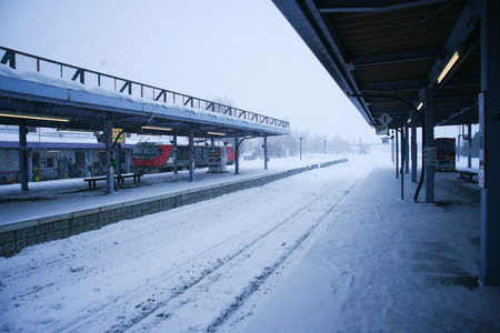 Landscape view of a train station in Otaru covered in snow