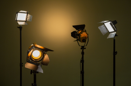 Halogen and led lights. Spotlights with Fresnel lenses. Studio photography. Photo and video shooting. Stock Photo
