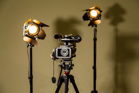 Camcorder and the two spotlights with Fresnel lenses. Filming in the interior or Studio