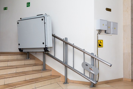 Stair lift for the disabled. Stairs of public building