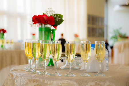 Champagne at the cocktail party. People in the background. Blurred background. Bokeh. Stock Photo