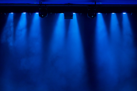nightspot: The blue light from the spotlights through the smoke in the theatre during the performance. Lighting equipment.