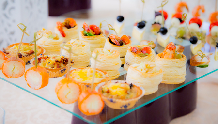 Delicacies and snacks in the buffet. Seafood. A gala reception. Banquet. Catering. Stock Photo