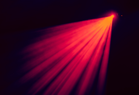 nightspot: The red light from the spotlights through the smoke at the theater during the performance. Lighting equipment. Stock Photo