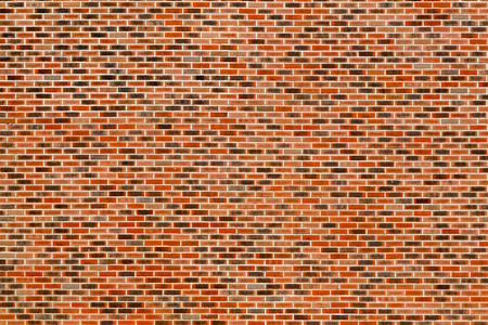 The brickwork is red-black with white seams. Texture, background. The wall of the building. Architectural element. Decor.