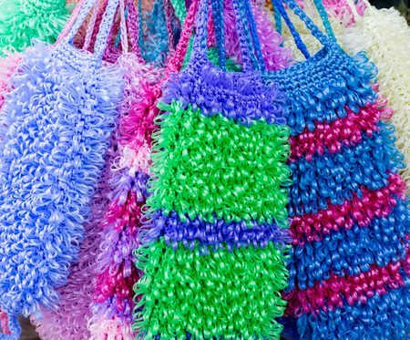 Colored washcloths. Handmade. Selling on the market. Stock Photo