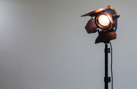 Spotlight with halogen bulb and Fresnel lens. Lighting equipment for Studio photography or videography