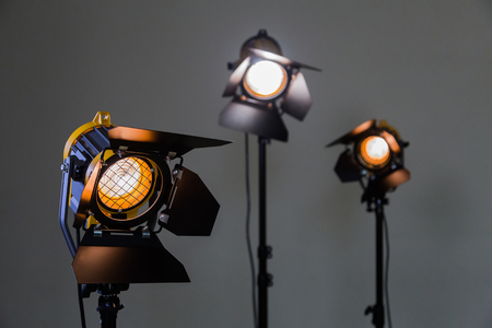 Three halogen spotlights with Fresnel lenses on a grey background. Photographing and filming in the & Movie Lighting Stock Photos. Royalty Free Movie Lighting Images ... azcodes.com