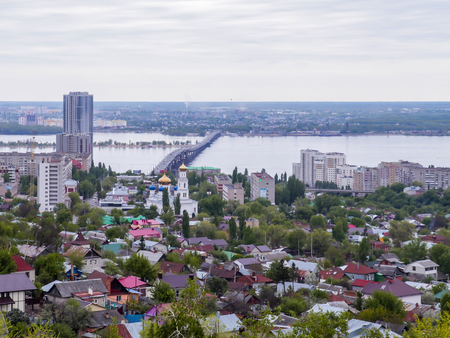 volga: Road bridge across the Volga river between the cities of Saratov and Engels. The citys skyline. An Orthodox Church. May.