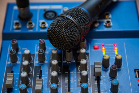 The equipment for recording. Microphone lying on sound mixing Board. Stock Photo