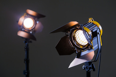 Two halogen spotlights with Fresnel lenses. Shooting in the Studio or in the interior. TV, movies, photos Banco de Imagens - 82740930